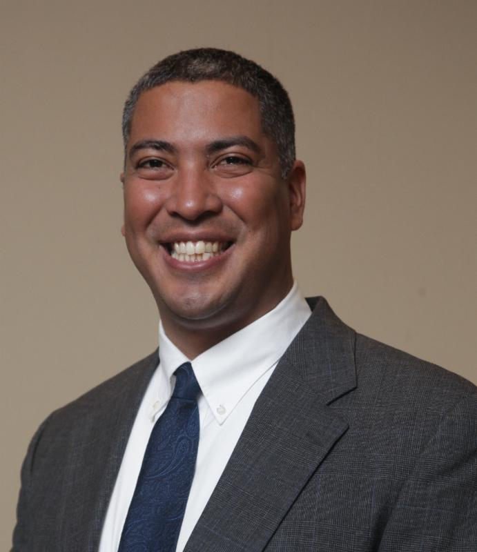 Portrait of Dr. Rafael E. Luna in bust_ smiling.