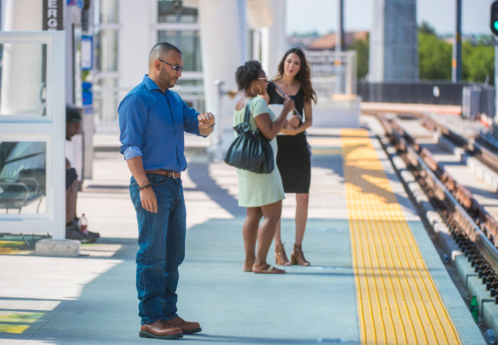 photo of people waiting for light rail in Aurora.
