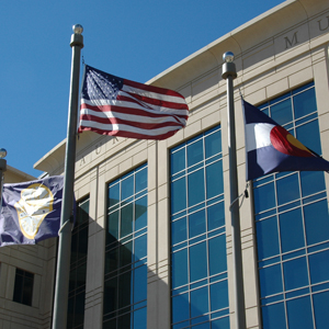 Flags fly at the Aurora Municipal Center