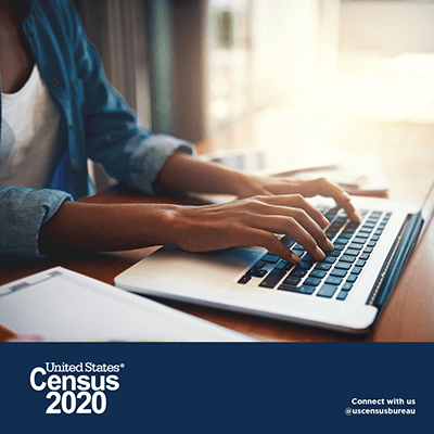 A person on a laptop with the Census 2020 logo