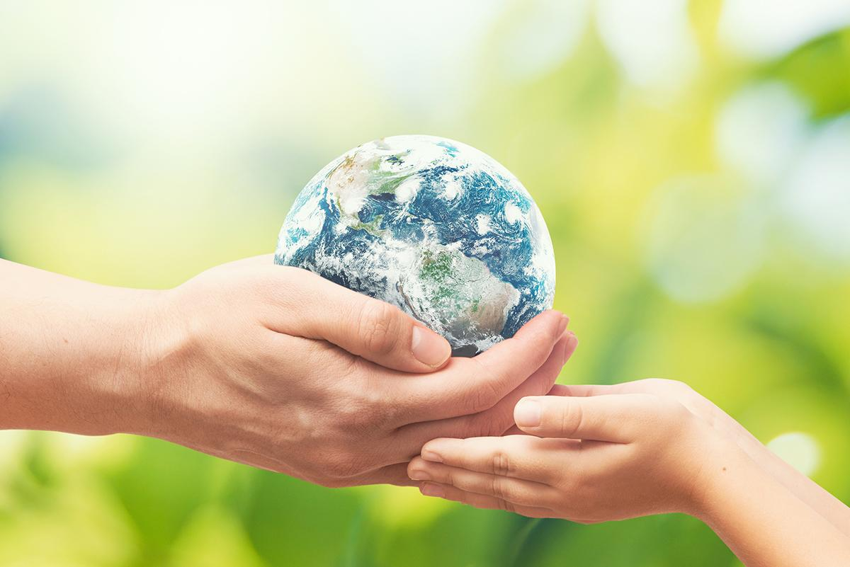 Earth Day image, two hands holding a globe