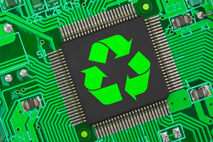 Image of a recycling symbol on top of a circuit board