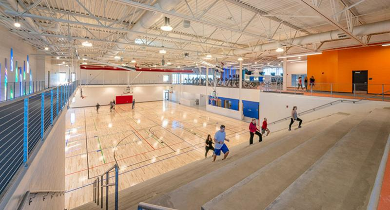 People run up the stairs at Central Rec Center gym which features basketball courts and a running track