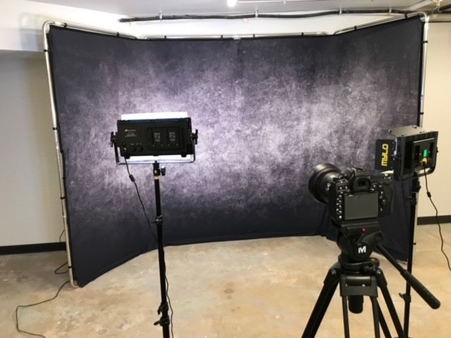 Image of photo backdrop with lighting and camera
