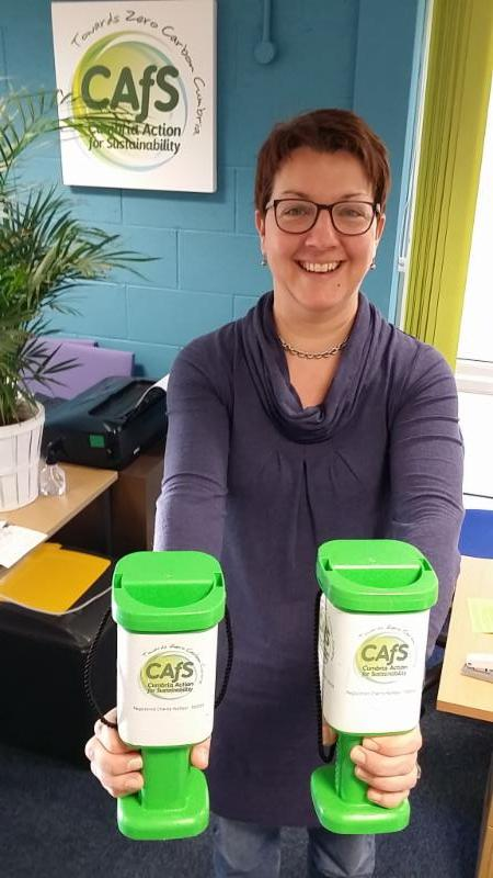 Emma with donation pots