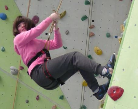 Girl climbing wall at Get Yourself Active