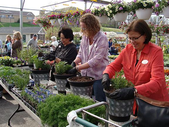 Booths and activities at Hillermann Nursery and Florist during Ladies Night Out on 4-26-18