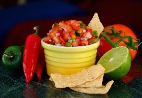 Fresh salsa with tomato, peppers and lime.