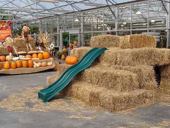 Fall hay bale slid and tunnel and fall plants and items at Hillermann Nursery and Florist