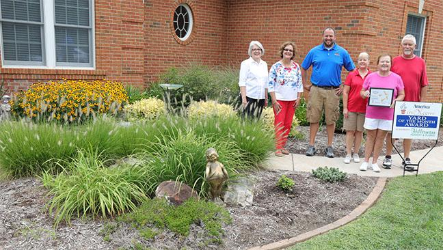 Washington In Bloom Yard of the Month Contest winners Ken and Diane Kluesner with contest sponsors and Washington In Bloom Members