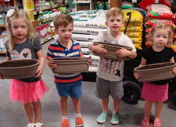 Kids with planters from Healthy Living Series event in 2016