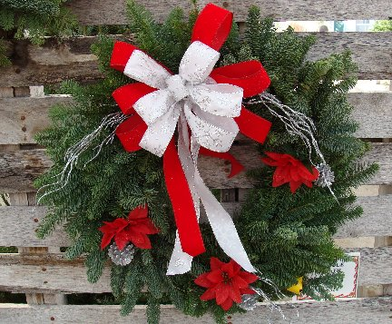 Fresh evergreen wreath for Holiday decorating available at Hillermann Nursery and Florist