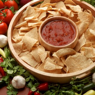 Salsa and chips with vegetables and herbs