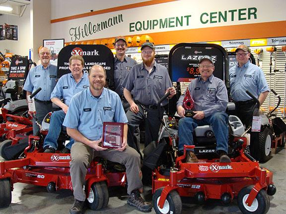 Hillermann Nursery and Florist Equipment Center receives two awards from Exmark. Hillermann staff and awards are in the picture.