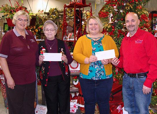 Picture of donations from Santa events being given to charities - December 2018 - Sandi from Hillermanns - Pat from Loving Hearts - Amanda from Graces Place and Rick from YHTI-Wisper Internet