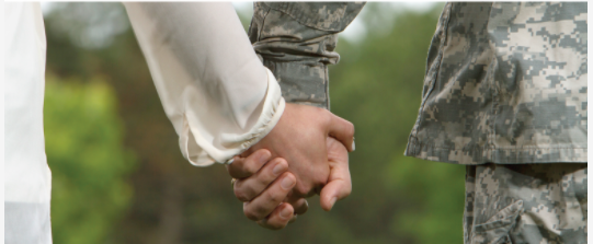 Holding hands with service member
