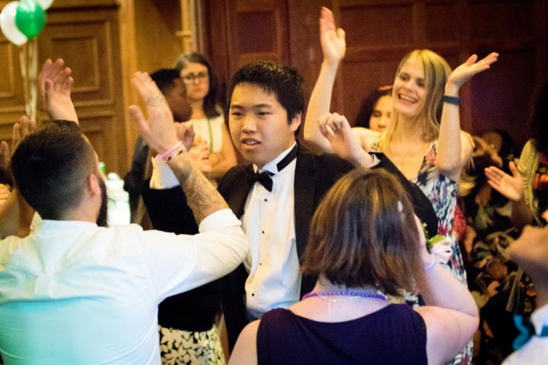 Students and staff dancing at Prom