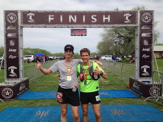 William Greer posing with his guide at the finish line of the Prickly Pear Ultramarathon in San Antonio_ Texas