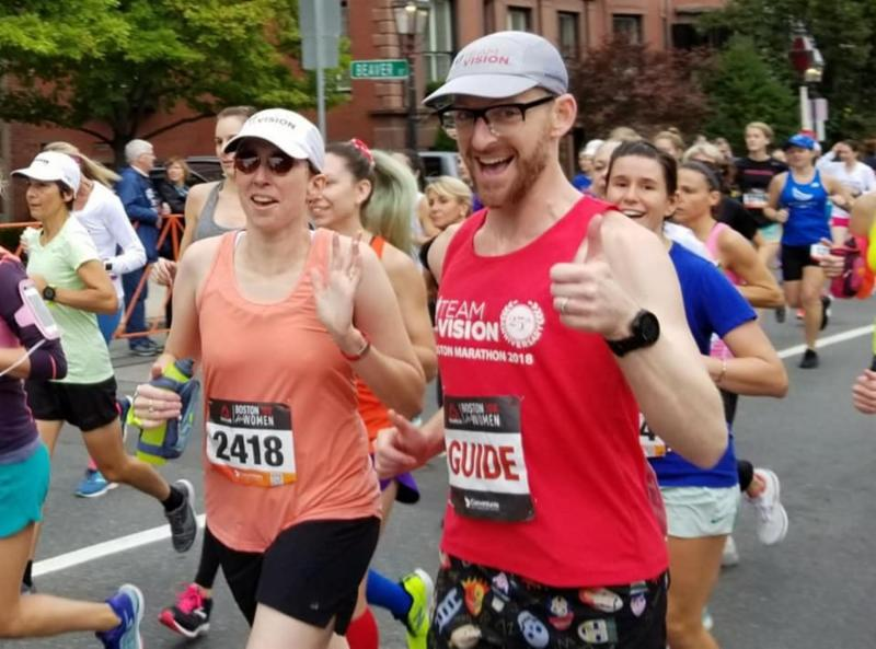 TWAV runner running with her guide in the Boston Marathon