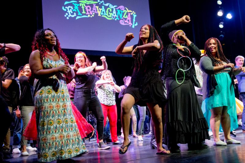 Students sing and dance on stage at Extravaganza 2016