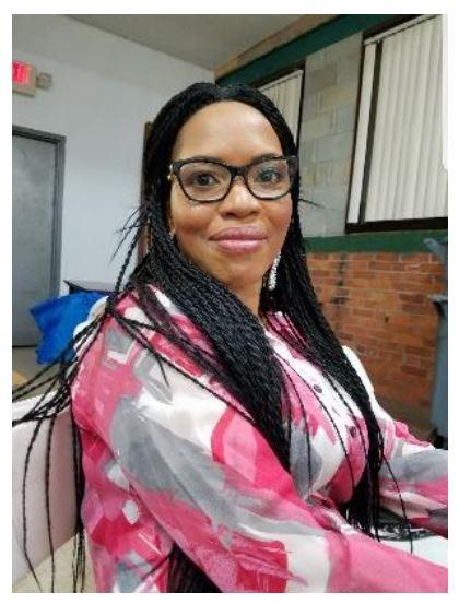 Adenike Ogundeide sitting at a desk