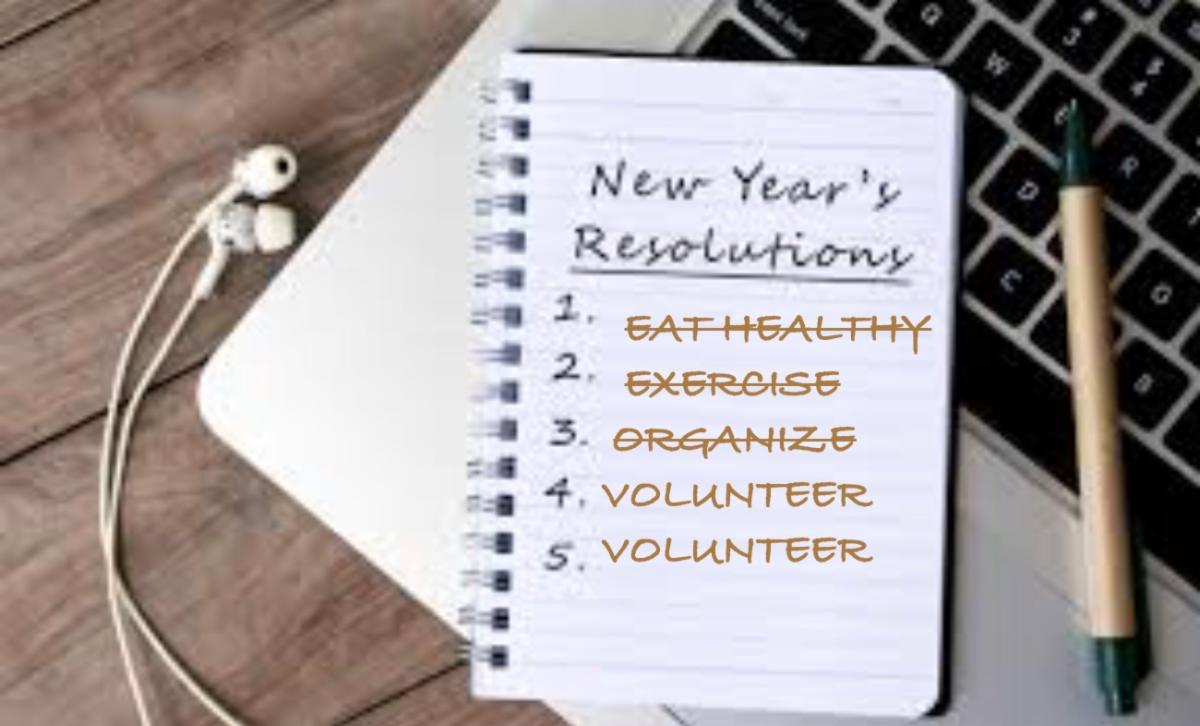 Image of a notepad on a keyboard. Text: New Year's Resolutions 1. eat healthy (scratched out) 2.Organize (scratched out) 4. Volunteer 5. Volunteer