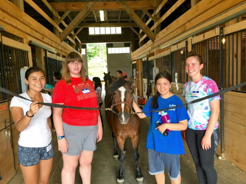 Students in Horsemanship group pose with a horse and BINA Center staff