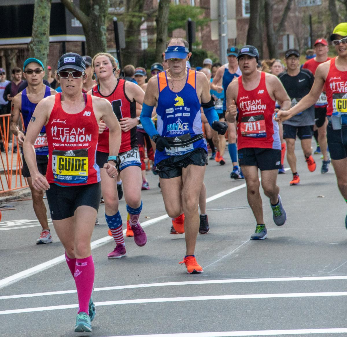Group of marathon runners including some VI runners and guides