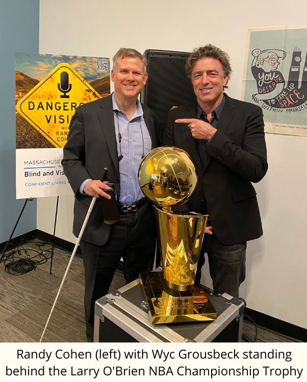 Randy Cohen (left) with Wyc Grousbeck standing behind the Larry O'Brien NBA Championship Trophy