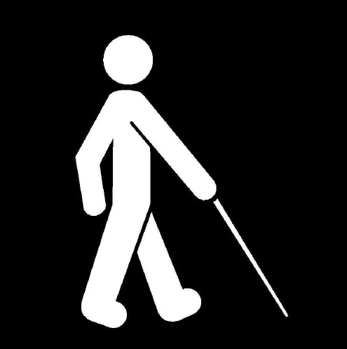 a black-and-white sign of a stick figure with a white cane