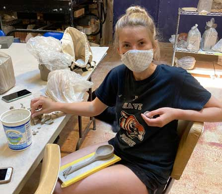 Megan Neary hand building a spoon