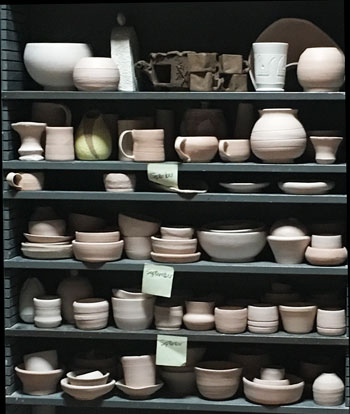 Crowded bisque shelves