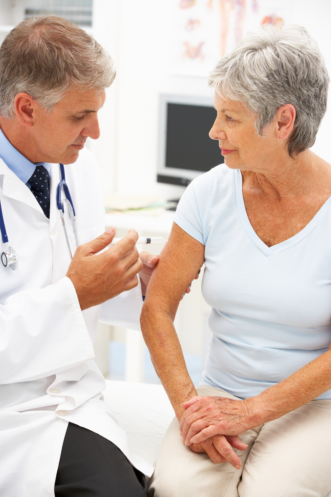 Doctor giving woman flu shot