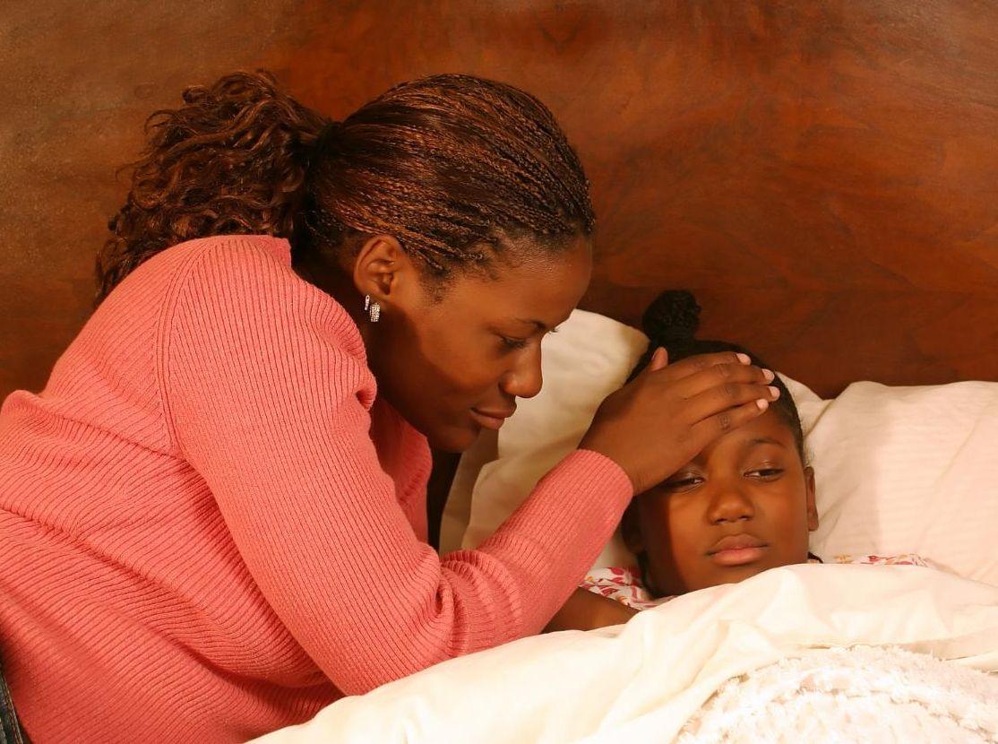 Mom and sick child flu