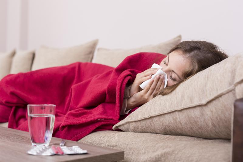 Woman ill with flu