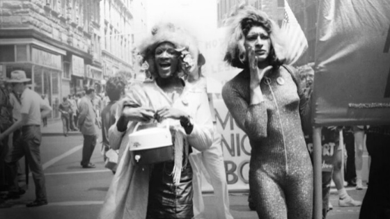 Photo of Marsha P. Johnson and Sylvia Rivera marching beside one another