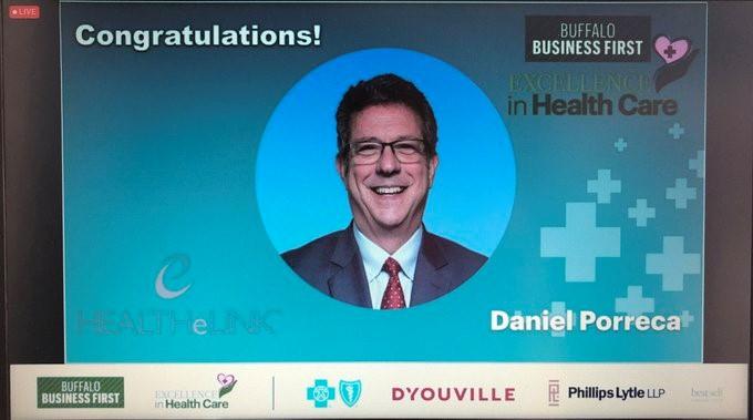 Dan Porreca_ HEALTHeLINK Executive Director_ received an award from Buffalo Business First