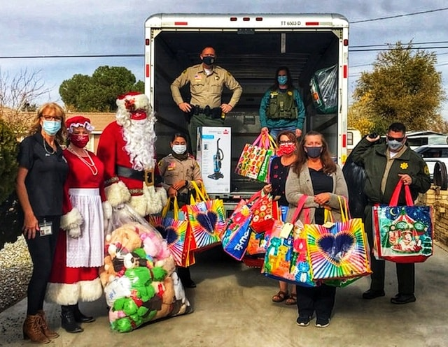 group of people unloading gifts from truck
