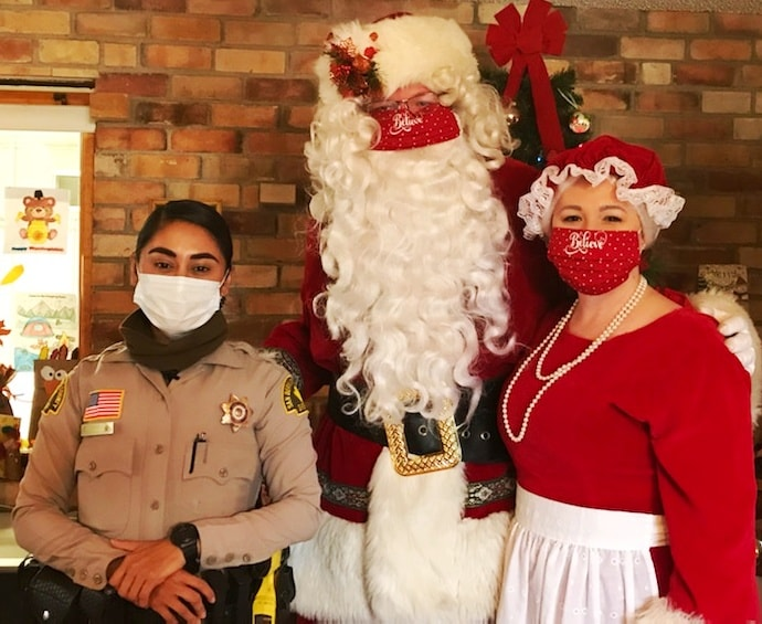 police officer with Mr. and Ms. Claus