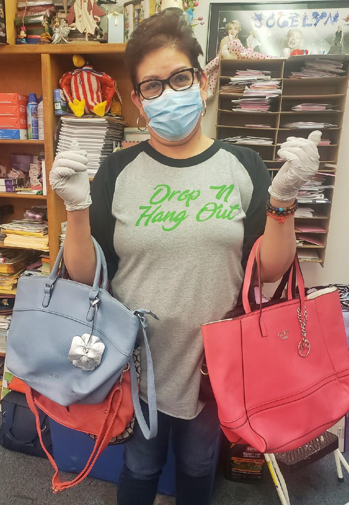 woman holding purses