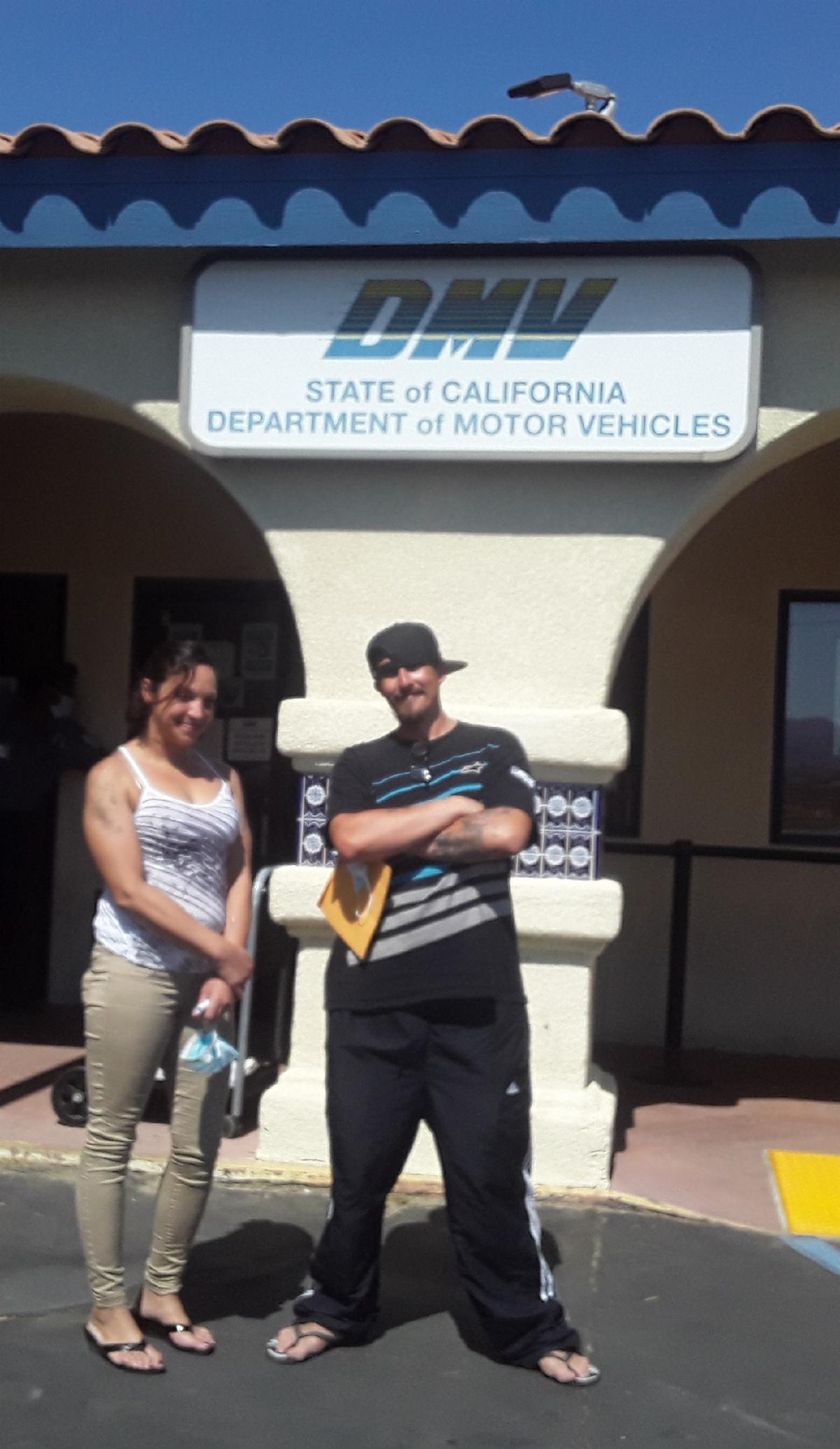 a couple in front of the DMV