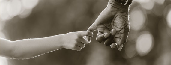 Photo of parent and child holding hands