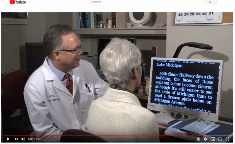 Doctor and patient in clinical setting during an eye exam
