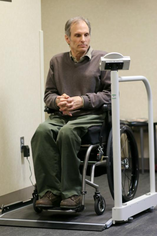 Bob Mikesic using a wheelchair accessible scale