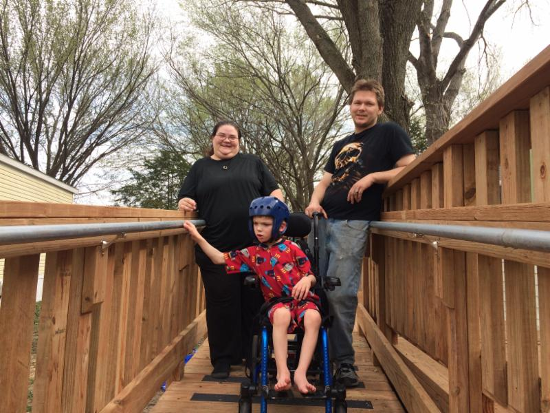 family of 3 smiling enjoying their new accessible ramp