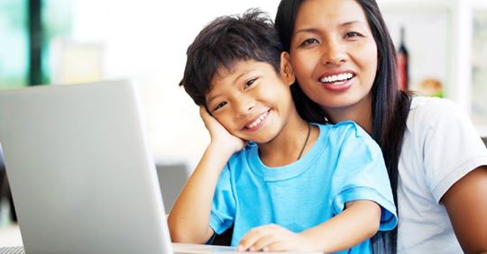 mother and son at a computer