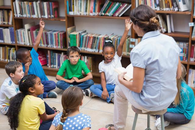 teacher in library with young children