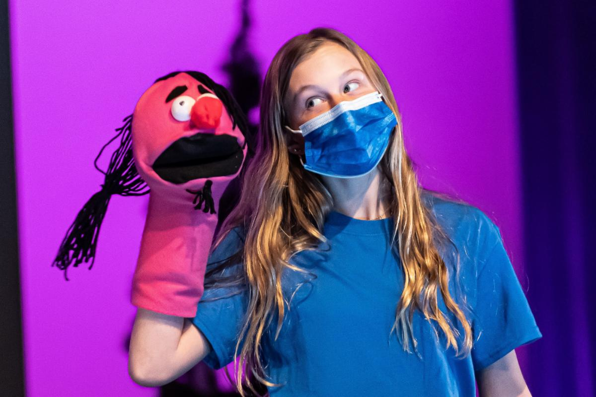student performing with puppet