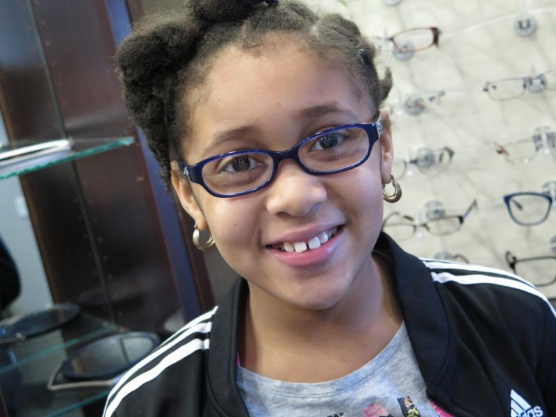 young student wearing her new glasses