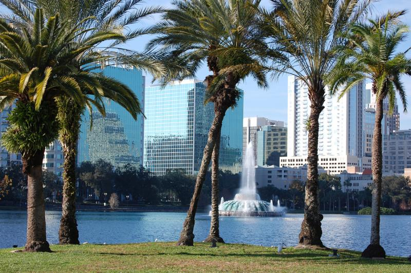 Orlando_ Florida with palm trees and fountain in foreground